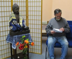Karma Tenzing Wangchuk reviews the poems he will present for discussion at a weekly Sangha meeting in the sanctuary of the Quaker Meetinghouse