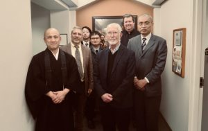 Participants gather in front of the astrology mandala of Shingon Buddhism displayed at the Pigott Building at Seattle University. From left Rev. Taijo, Dr. Peduti, Prof. Tokushige, Prof. Kikuya, Dr. Ely, Dr. Wirth, Prof. Sato