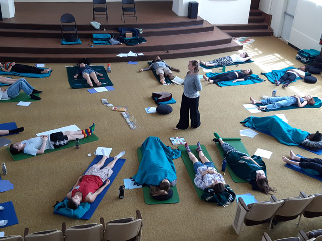 Teens practice mindfulness while prone, a favorite during the retreat.