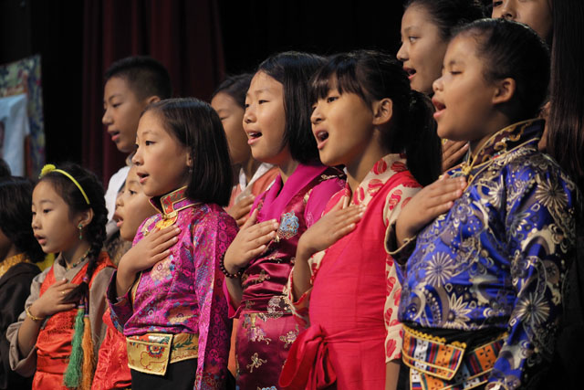 Children from the Tibetan Language and Culture School sing the Star Spangled Banner to open the event