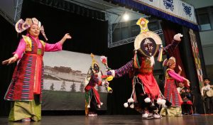 Former artists from the Tibetan Institute of Performing Arts performing a Tibetan opera
