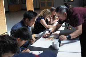 Artist Tamdin leading a free Tibetan calligraphy workshop