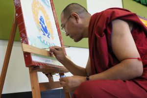 Lama Migmar leading a thangka painting workshop