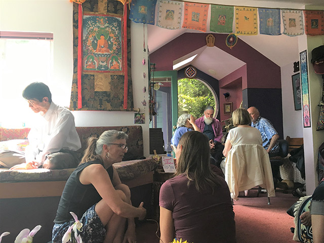 Participants deeply reflect during the Seattle salon exploring climate change, deep adaptation, and the Dharma