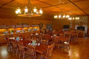 People can gather for meals or reminisce inside the main lodge, in the casual lounge space by the stone fireplace