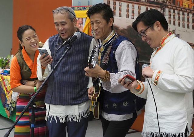 Sonam Nyatsatsang sings a group song fellow board members at the Tibetan community new year party at Northgate College