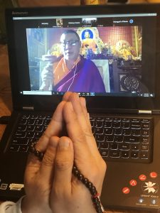A community member participating in a monthly prayer session, on Zoom