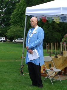 Timothy wearing his vestments at a Buddhist festival